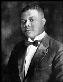 Photo of a young Louis Armstrong in a tuxedo