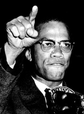 Black & White photo of Malcolm X speaking