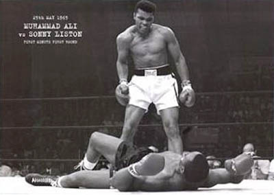 Photgraph of Muhammad Ali standing over a prostrate Sonny Liston