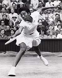 Photograph of Althea Gibson hitting a ground stroke during a tennis tournament