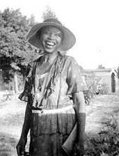 Photograph of Zora Neale Hurston smiling and laughing