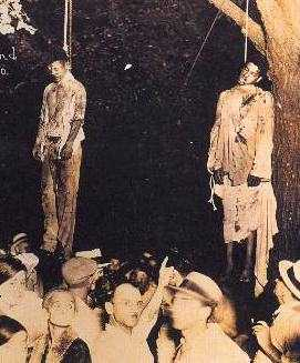 Sepia-toned photograph of two Negro youths who have been lynched