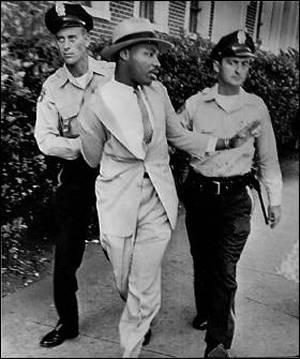 Photo of Martin Luther King Jr. being arrested